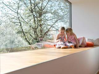 Cherry Blossom House (German Passivhaus) Modern style bedroom by ÜberRaum Architects Modern
