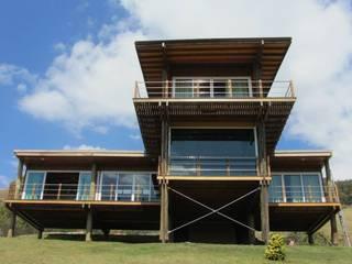 rustic Houses by Cabana Arquitetos