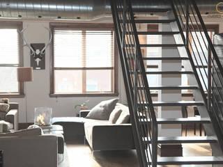 Cervus Collection Ambiente Salones de estilo ecléctico de Rivero Cano Design Ecléctico