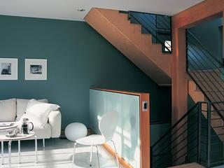 Exemples de realisations Couloir, entrée, escaliers modernes par Agence B Interior Moderne