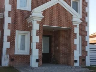 Arquitectos Building M&CC - (Marcelo Rueda, Claudio Castiglia y Claudia Rueda) Casas de estilo rústico