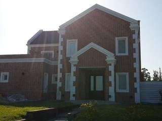 Arquitectos Building M&CC - (Marcelo Rueda, Claudio Castiglia y Claudia Rueda) Rustic style houses