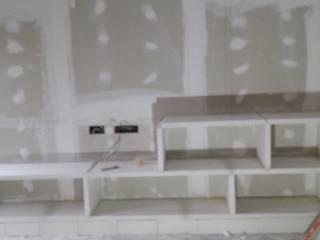 Mueble en salón con estanterias de escayola de Escayolas Colunga
