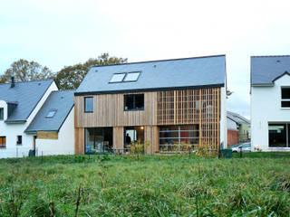 Mini/Maxi: Maisons de style  par LAUS architectes