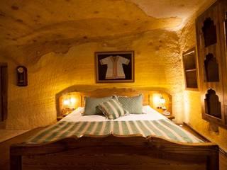 Dormitorios de estilo rústico de Kayakapi Premium Caves - Cappadocia Rústico