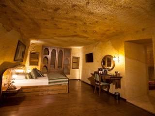 Dormitorios rústicos de Kayakapi Premium Caves - Cappadocia Rústico