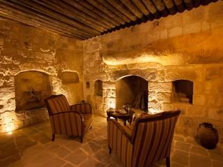 Kayakapi Premium Caves - Cappadocia – Kuşçular Konağı Öncesi Ve Sonrası:  tarz Oturma Odası