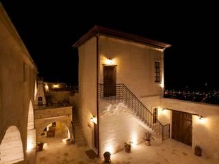 Дома в рустикальном стиле от Kayakapi Premium Caves - Cappadocia Рустикальный