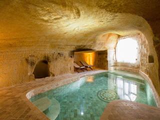 Piscinas de estilo rústico de Kayakapi Premium Caves - Cappadocia Rústico