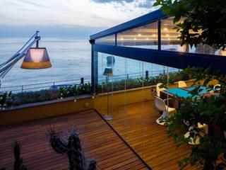 Struttura per Esterno Gibus - Hotel Capo la Gala: Giardino d'inverno in stile  di Home Interni d'Arte