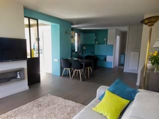 RENO Appartement L: Salon de style  par EI. SOPHIE BANNWART