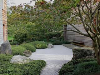 Jardines asiáticos de Paul Marie Creation Garden Design & Swimmingpools Asiático