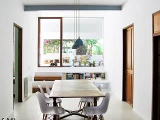 Reforma y Ampliación de una Vivienda Unifamiliar Comedores de estilo moderno de SMXL arquitectos Moderno