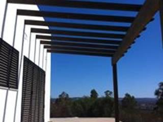 VIVIENDA DE FIN DE SEMANA: Terrazas de estilo  de Oficina de Arquitectura 110