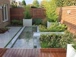 Jardines de estilo  por Hoveniersbedrijf Guy Wolfs