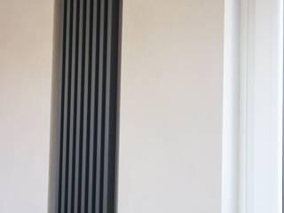 Abitazione privata, Milano.: Pareti in stile  di abele lalli architetto