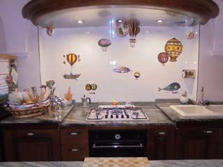 Vista cucina: Cucina in stile in stile Eclettico di a10studioarchitettura