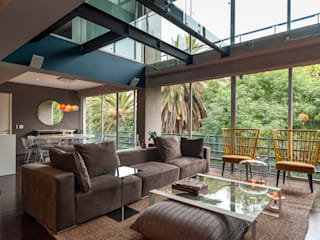 MAAD arquitectura y diseño Ruang Keluarga Gaya Eklektik