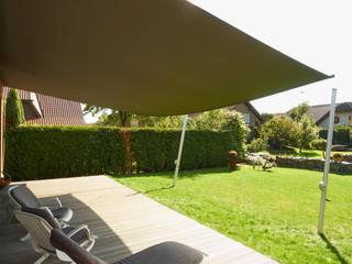 Elektrische Sonnensegel Markise in aufrollbarer Ausführung: mediterraner Garten von Pina GmbH - Sonnensegel Design
