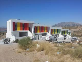 VIVIENDAS DE PROTECCIÓN OFICIAL Casas de estilo moderno de AMARQUITECTURA Moderno