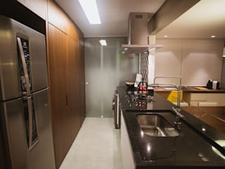 APARTAMENTO GS114: Cozinhas  por Aquadrado Arquitetura