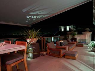 Park Lane Penthouse:  Terrace by Debbie Flevotomou Architects Ltd.