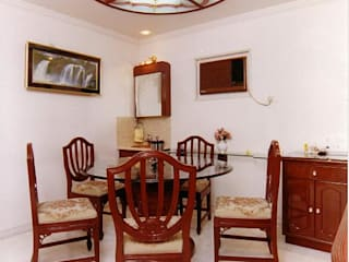 Dining room by NAMAN INTERIORS - Turnkey Interior Contractors,