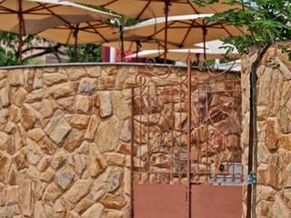 Restaurante Boiabá - Churrascaria Al Carte Espaços gastronômicos rústicos por Atmosfera Arquitetura Sociedade Ltda Rústico