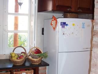 Cocinas de estilo  por milena oitana,