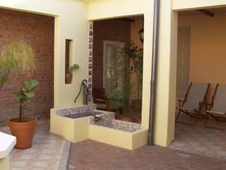 milena oitana Rustic style garden