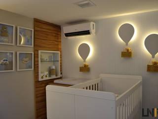 UNIO Arquitetura Nursery/kid's roomBeds & cribs