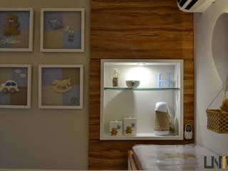 UNIO Arquitetura Nursery/kid's roomWardrobes & closets