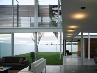 Pareti & Pavimenti in stile minimalista di Echauri Morales Arquitectos Minimalista