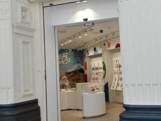 SWATCH ZARAGOZA: Oficinas y Tiendas de estilo  de AI3D ARQUITECTOS
