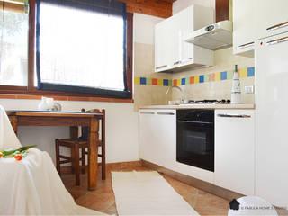 Casa  al mare | Quartu Sant'Elena | Cagliari | Sardegna: Cucina in stile in stile Mediterraneo di Fabula Home Staging