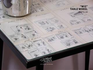 WIZ Table Wheel:  in stile  di simona ricci creative interiors