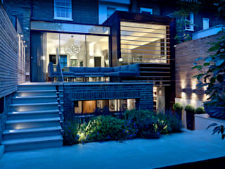 ​Garden Terrace at Newton Road House in the evening.:  Terrace by Nash Baker Architects Ltd