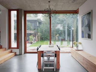 Salle à manger de style  par Holzerarchitekten, Moderne