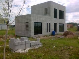 Casa de bloques 20-40: Casas de estilo  por Arq. Luciano Altube,Moderno