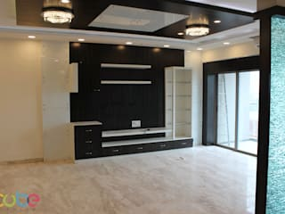 Residential Appartment @ Phoenix Market city - Chennai:  Living room by ECUBE INTERIOR SOLUTIONS PVT LTD