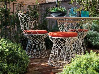 Studio Architettura del Paesaggio Giardini Giordani di Luigina Giordani Modern Garden Metal Orange