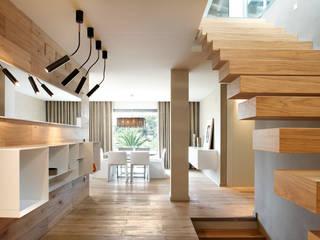 Modern Corridor, Hallway and Staircase by ruiz narvaiza associats sl Modern