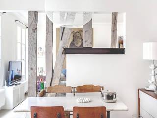 Столовая комната в стиле модерн от cristina velani Модерн