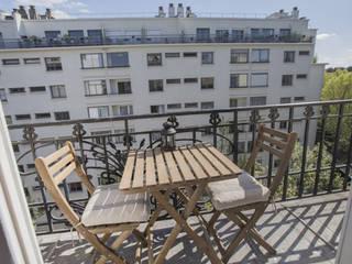 APPARTEMENT SIMON BOLIVAR 35 M2: Terrasse de style  par cristina velani