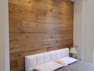 RISTRUTTURAZIONE APPARTAMENTO IN EDIFICIO LIBERTY: Camera da letto in stile in stile Moderno di MBA  MARCELLA BRUGNOLI ARCHITETTO