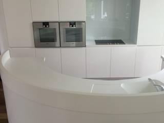 Kitchen with semicircular corian island Modern kitchen by century Modern