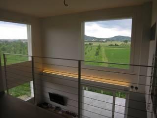 Villa bifamiliare in Forlimpopoli Soggiorno moderno di Studio di Architettura e Ingegneria Brasina-Rubino Moderno