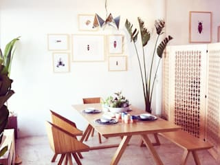 Tropical style dining room by Clorofilia Tropical