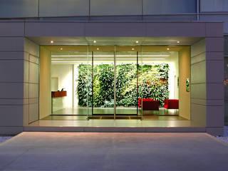 Madel Head Office: Complessi per uffici in stile  di Davide Randi Architetto