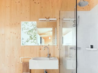 Baños de estilo  por dom arquitectura